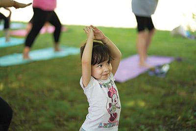 Girl doing yoga in park